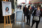 Outside Waterstones in Piccadilly, women walk past a publicity board for the eagerly-anticipated bestselling title, Becoming by the former First Lady of the United States, Michelle Obama, before her December publicity tour of the UK, on 13th November 2018, in London, England.