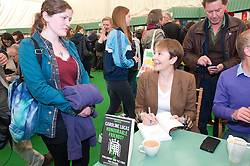 © London News Pictures. 29/05/2015. Hay-on-Wye, Powys, Wales, UK. Caroline Lucas signs copies of her book - Honourable Friends - at the Hay Festival 2015. Photo credit: Graham M. Lawrence/LNP.