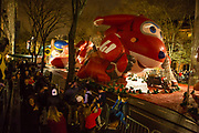 New York, NY – 27 November 2019. Thousands of spectators packed the streets around the American Museum of Natural History to see the inflation area for the balloons for Macy's Thanksgiving Day Parade. People pause for photos before Mighty Morphin Power Ranger.