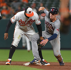 June 21, 2017 - Baltimore, MD, USA - The Cleveland Indians' Bradley Zimmer, right, steals second base as the Baltimore Orioles' Jonathan Schoop is late with the tag in the ninth inning at Oriole Park at Camden Yards in Baltimore on Wednesday, June 21, 2017. The Indians won, 5-1. (Credit Image: © Lloyd Fox/TNS via ZUMA Wire)