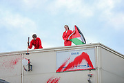 Liverpool, Britain, June 10, 2021: Palestine Action activists have scaled the roof of an aerospace factory and daubed the building in red paint on Thursday, June 10, 2021. They claim the factory produces landing gear for Elbit drones which have been used in the conflict between Israel and Hamas in Gaza. APPH's website says it manufactures hydraulic equipment for military helicopters and fighter jets. (Photo by Vudi Xhymshiti)