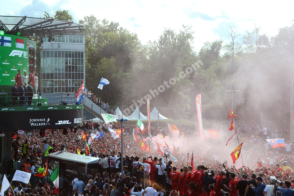 Charles Leclerc (Ferrari) with Valtteri Bottas and Lewis Hamilton (both Mercedes) on the podium in front of fans / tifosi after the 2019 Italian Grand Prix in Monza. Photo: Grand Prix Photo