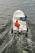 Nederland, Mook, 28-7-2018 Het kanaal van de Maas naar de Mookse plas wordt deze dag met het warme weer veel gebruikt door mensen met een boot om een stuk over de rivier de Maas te varen . Foto: Flip Franssen