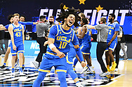 INDIANAPOLIS, IN - MARCH 30: Tyger Campbell #10 of the UCLA Bruins celebrates their win over the Michigan Wolverines in the Elite Eight round of the 2021 NCAA Division I Men's Basketball Tournament held at Lucas Oil Stadium on March 30, 2021 in Indianapolis, Indiana. (Photo by Brett Wilhelm/NCAA Photos via Getty Images)