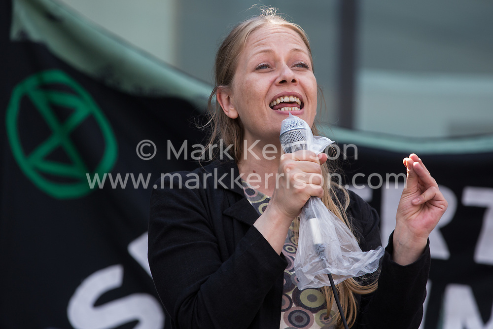 London, UK. 5th June, 2021. Sian Berry, co-leader of the Green Party, addresses environmental activists and local residents protesting against the construction of the Silvertown Tunnel. Campaigners opposed to the controversial new £2bn road link across the River Thames from the Tidal Basin Roundabout in Silvertown to Greenwich Peninsula argue that it is incompatible with the UK's climate change commitments because it will attract more traffic and so also increased congestion and air pollution to London's most polluted borough.