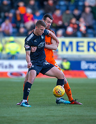 Falkirk's Andrew Nelson and Dundee United's Paul Quinn. half time : Falkirk 2 v 1 Dundee United, Scottish Championship game played 6/1/2018 played at The Falkirk Stadium.