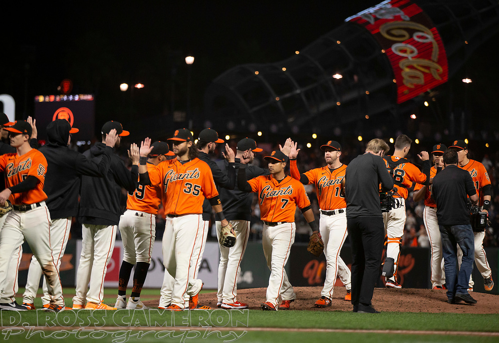 Oct 1, 2021; San Francisco, California, USA; San Francisco Giants players celebrate their 3-0 victory over the San Diego Padres at Oracle Park. Mandatory Credit: D. Ross Cameron-USA TODAY Sports