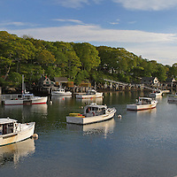 New Harbor, Maine nested into the granite seacoast away from the Atlantic Ocean in Maine on a beautiful New England late afternoon. New Harbor is a small coastal village in the town of Bristol in Lincoln County of Maine. The picturesque New England village is a working harbor residing on the mid-coast of Maine and has a rich history of fishing, lobster boating and boat building. New Harbor is located on the beautiful Pemaquid Peninsula that also calls home to one of the moist iconic lighthouses in New England, Pemaquid Head Light. Fort William Henry is nearby too. Life is simple, peaceful and relaxed in New Harbor.<br /> <br /> This scenic Maine harbor scene photo is available as museum quality photography prints, canvas prints, acrylic prints or metal prints. Fine art prints may be framed and matted to the individual liking and decorating needs:<br /> <br /> http://juergen-roth.pixels.com/featured/maine-new-harbor-scenery-juergen-roth.html<br /> <br /> All photographs are available for digital and print image licensing at www.RothGalleries.com. Please contact me direct with any questions or request.<br /> <br /> Good light and happy photo making!<br /> <br /> My best,<br /> <br /> Juergen<br /> Prints: http://www.rothgalleries.com<br /> Photo Blog: http://whereintheworldisjuergen.blogspot.com<br /> Twitter: @NatureFineArt<br /> Instagram: https://www.instagram.com/rothgalleries<br /> Facebook: https://www.facebook.com/naturefineart