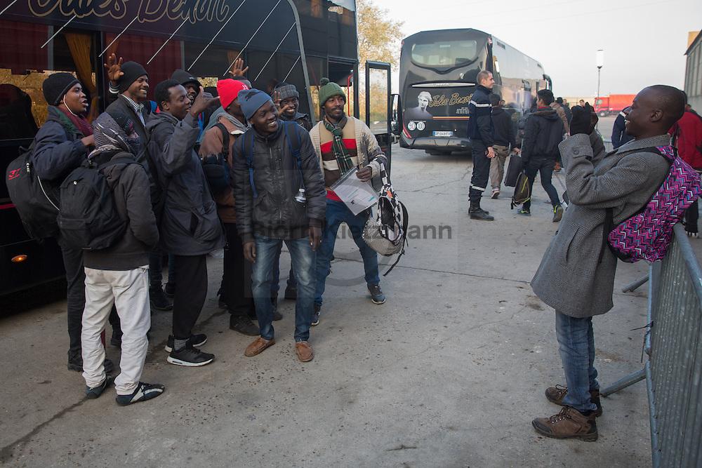 """Calais, Pas-de-Calais, France - 25.10.2016    <br />  <br /> Refugees and migrants at the registration shelter. After registration, they are taken by bus to various camps in whole France. 2nd day of the eviction on the so called """"Jungle"""" refugee camp on the outskirts of the French city of Calais. Many thousands of migrants and refugees are waiting in some cases for years in the port city in the hope of being able to cross the English Channel to Britain. French authorities announced a week ago that they will evict the camp where currently up to up to 10,000 people live.<br /> <br /> Fluechtlinge und Migranten in der Registrierungszone. Nach der Registrierung werden sie mit Bussen auf Camps in ganz Frankreich aufgeteilt. Zweiter Tag der Raeumung des so genannte """"Jungle""""-Fluechtlingscamp in der französischen Hafenstadt Calais. Viele tausend Migranten und Fluechtlinge harren teilweise seit Jahren in der Hafenstadt aus in der Hoffnung den Aermelkanal nach Großbritannien ueberqueren zu koennen. Die franzoesischen Behoerden kuendigten vor einigen Wochen an, dass sie das Camp, indem derzeit bis zu bis zu 10.000 Menschen leben raeumen werden. <br /> <br /> Photo: Bjoern Kietzmann"""