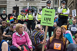 London, UK. 2nd September, 2021. Extinction Rebellion climate activists protest in front of the Bank of England in the City of London on the eleventh day of Impossible Rebellion protests. Over 50 of the activists wore signs indicating that they were breaking restrictive bail conditions by entering the City of London. Extinction Rebellion are calling on the UK government to cease all new fossil fuel investment with immediate effect.
