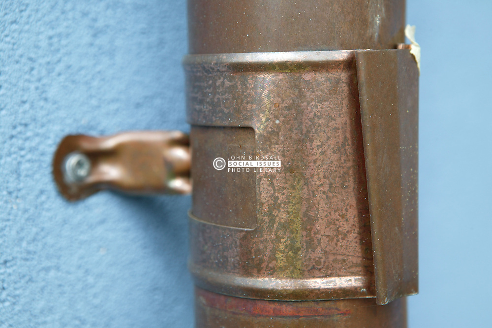 Recyclable copper down pipe on Eco House at The Wintles; Bishop's Castle; an alternative to environmentally damaging pvc,