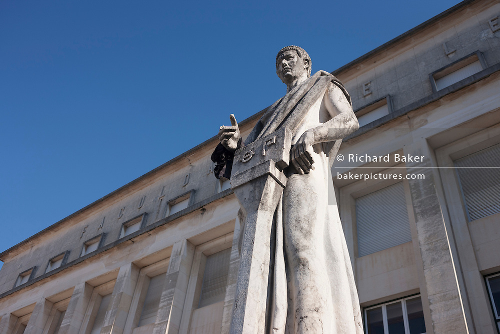 Statue in front of the Faculty of Letters, Praca da Porta Ferrea, Coimbra University, Portugal.