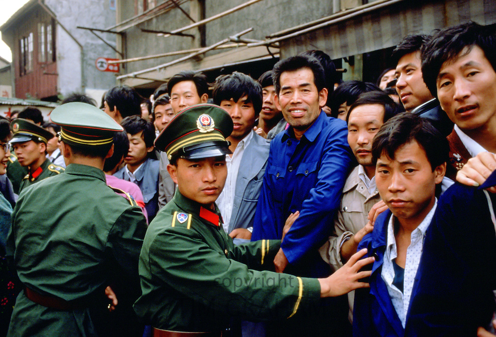 Shanghai police restrain crowd, China