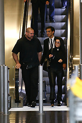 Kim's driver Gary Madar with Kourtney Kardashian arrives at Charles De Gaulle airport in Roissy near Paris, France on September 29, 2016. Kim's drivers Mickael Madar and his brother Gary Madar are the main suspects three months after the Kim Kardashian' robbery in a mansion in Paris during Fashion Week, the police conducted an extensive dragnet. 16 people aged 23-73 years arrested at 6am this morning in Paris and suburb. Photo by ABACAPRESS.COM