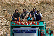 Locals riding on the roof of a petrol truck, the standard method of public transport on the Interoceanic Highway