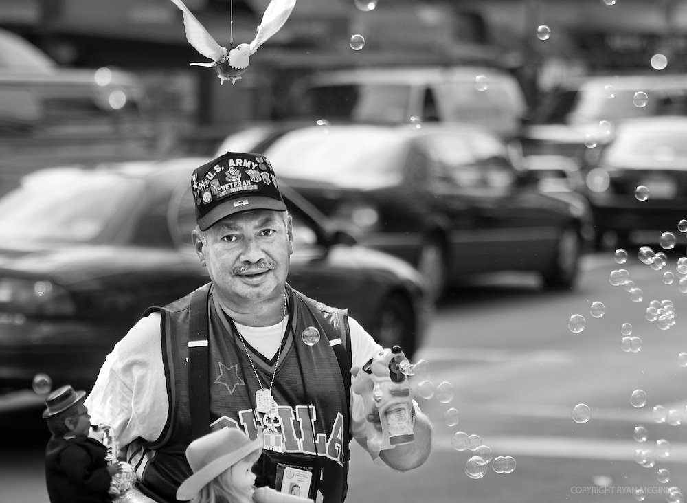 Candid of a man selling items in New York City, August 14, 2006.