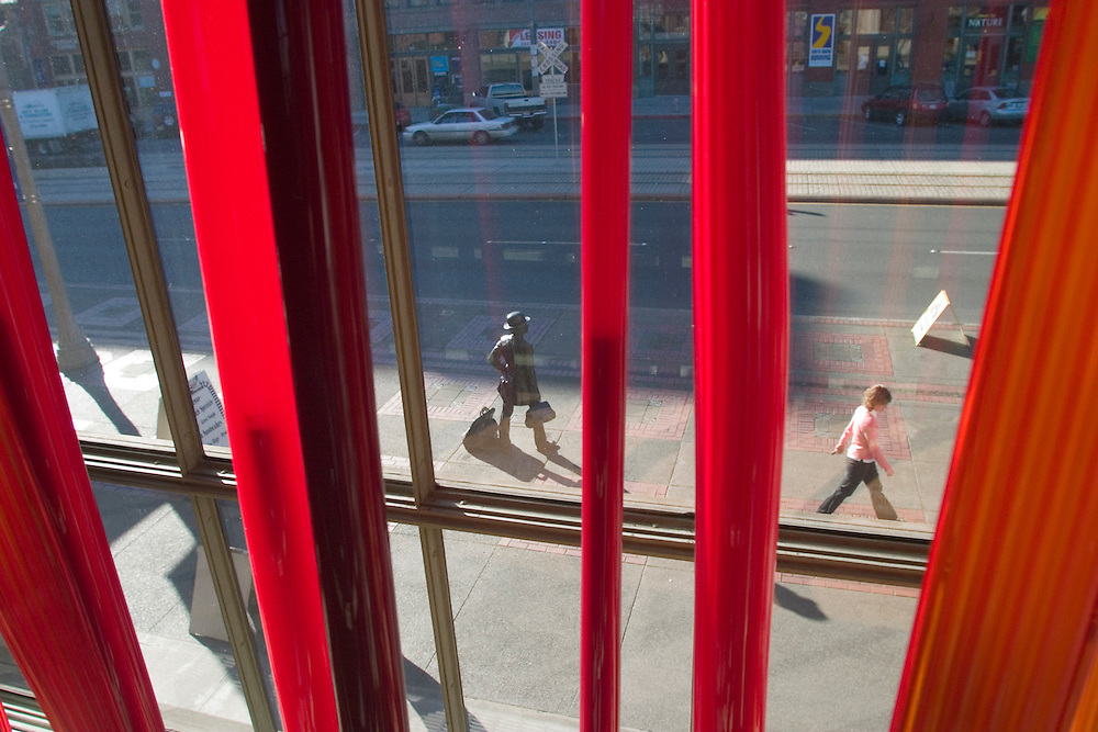 Pedestrians on street viewed through art glass (by Dale Chihully) in Union Station, Tacoma, Washington, United States