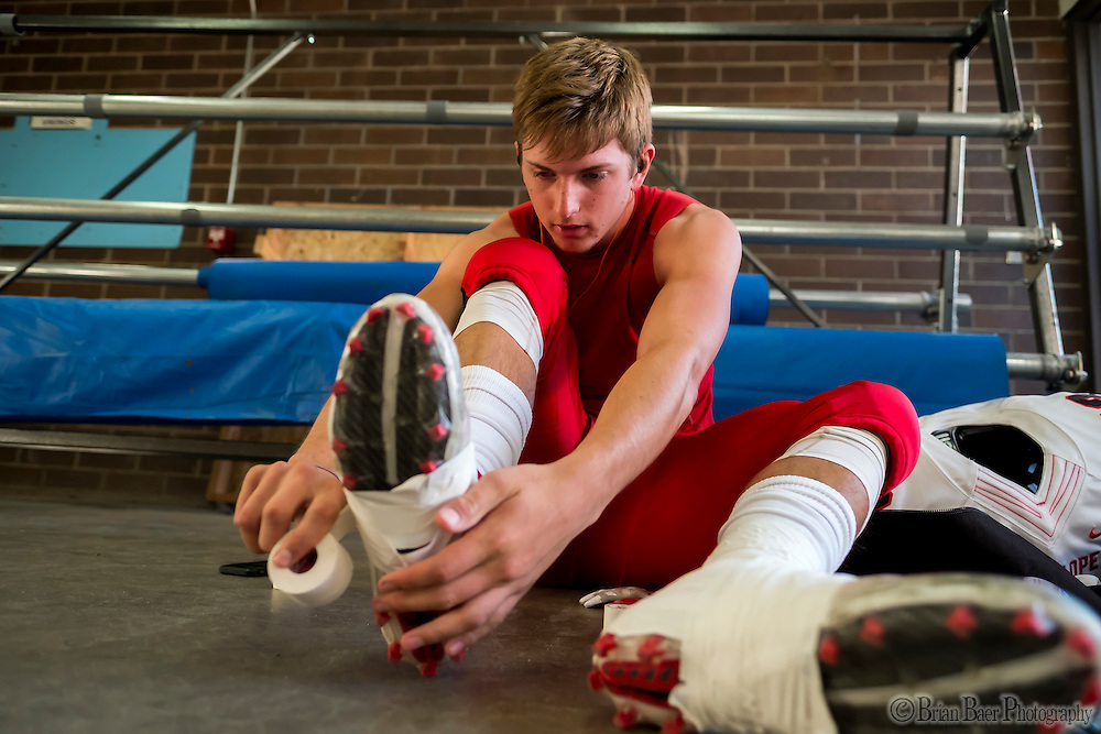 Antelope High School Titans Nick Hansen (42), gets ready inside the locker room before the game as the Oakmont High School Vikings host the Antelope High School Titans Friday Sep 30, 2016.<br /> photo by Brian Baer