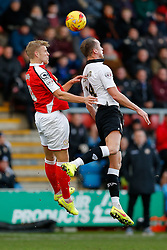 Harry Davis of Crewe Alexandra and Aaron Wilbraham of Bristol City compete in the air - Photo mandatory by-line: Rogan Thomson/JMP - 07966 386802 - 20/12/2014 - SPORT - FOOTBALL - Crewe, England - Alexandra Stadium - Crewe Alexandra v Bristol City - Sky Bet League 1.