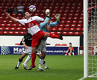 Photo: Mark Stephenson.<br /> Walsall v Port Vale. Coca Cola League 1. 08/09/2007.Walsall's Anthony Gerrard challenges Port Vale's keeper joe Anyon
