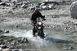 Round the World Doug Wothke made his way through a fun spot as we were beginning to understand water would keep crossing our path on day-4 of our Himalayan Heroes adventure riding from Pokhara to Kalopani, Nepal. Friday, November 9, 2018. Photography ©2018 Michael Lichter.