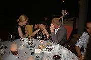 Tilda Swinton, Joanna Briscoe and Tim Lott. Dinner at L'Archipel Restaurant hosted by Patrice Binet-Descamps. Prince Maurice. Mauritius. 25 May 2006. ONE TIME USE ONLY - DO NOT ARCHIVE  © Copyright Photograph by Dafydd Jones 66 Stockwell Park Rd. London SW9 0DA Tel 020 7733 0108 www.dafjones.com