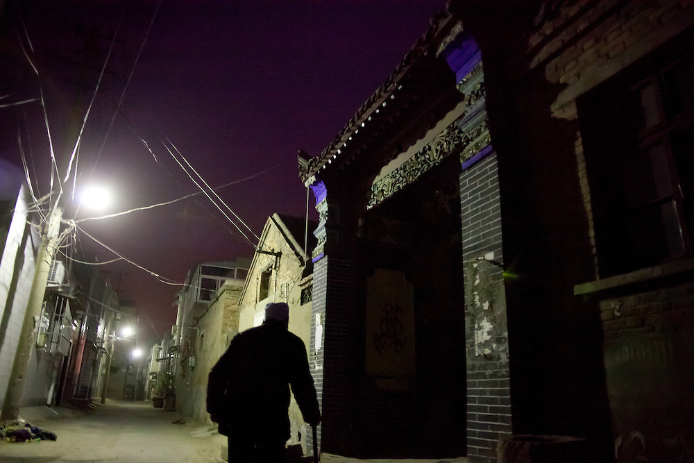 Early morning before pre-dawn prayer outside the Wangjia Hutong Women's Mosque in Kaifeng, Henan province, China. The mosques began as Quranic schools for girls in the late 17th century. They were the only places girls could receive an education; now, they also serve as community centers.