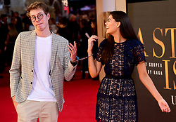 Callum Leighton Airey and Emily Canham are handcuffed together whilst attending the UK Premiere of A Star is Born held at the Vue West End, Leicester Square, London.