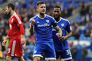 Cardiff City's Joe Ralls © celebrates after scoring his teams 1st goal from a penalty with team mate Junior Hoilett (r). EFL Skybet championship match, Cardiff city v Birmingham City at the Cardiff City Stadium in Cardiff, South Wales on Saturday 11th March 2017.<br /> pic by Carl Robertson, Andrew Orchard sports photography.