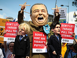 © Licensed to London News Pictures. 20/07/2019. London, UK. An anti-Brexit protester dressed as Brexit Party Leader Nigel Farage with puppets of Boris Johnson and Jeremy Hunt joins the March for Change in London. Photo credit: Rob Pinney/LNP