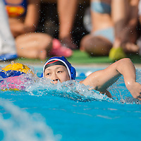 Teng Fei of China leads the ball during the women waterpolo friendly match of Hungary and China in Tatabanya, Hungary on June 23, 2012. ATTILA VOLGYI
