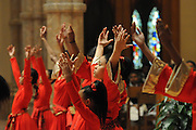 """Liturgical dancer Renisha Malik, 14, performs with fellow Chicago Catholic Schools students during the 33rd Annual African American Heritage Month Eucharistic Celebration at Holy Name Cathedral. This year's mass celebrates the the Nguzo Saba principle of Kuumba, or """"creativity"""" at Holy Name Cathedral."""