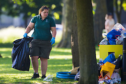 A worker in Queens Park loads rubbish bags with detritus left behind by park visitors. Following the hottest May bank holiday weekend on record, park workers have their work cut out creating up the mess left behind by picnickers. London, May 08 2018.