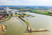 Nederland, Zeeland, Terneuzen, 09-05-2013; Sluizencomplex Terneuzen. Ingang van Kanaal Terneuzen-Gent. Sleepboten. Op de landtong Middenhavendam de Verkeerspost van Rijkswaterstaat (wordt uitgebreid tot Nautische Centrale Terneuzen).<br /> View on the sluices  of Terneuzen. Tugs. The city of Terneuzen (l).  <br /> On the spit of land the building of the Traffic Station of Public Works.<br /> luchtfoto (toeslag op standard tarieven)<br /> aerial photo (additional fee required)<br /> copyright foto/photo Siebe Swart