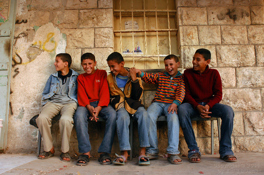 Palestinian boys sitt on a bench in the center of Qaffin, a small village in the northern West Bank, on November 24, 2003...Photo by Erin Lubin