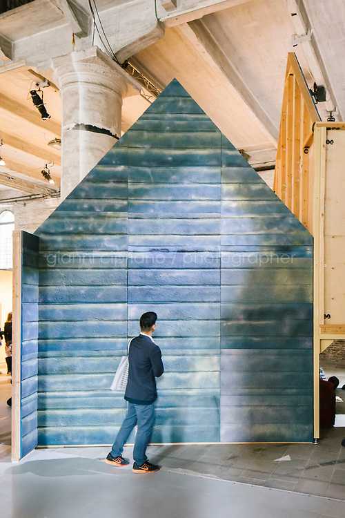 """VENICE, ITALY - 8 MAY 2019: A visitor is seen here by """"THERE IS NO SUCH THING AS OUTSIDE"""" (2017-2019) by Kaari Upson, here at the Arsenale during the 58th International Art Exhibition of La Biennale di Venezia in Venice, Italy, on May 8th 2019.<br /> <br /> The 58th International Art Exhibition of La Biennale di Venezia, titled """"May You Live In Interesting Times"""",is curated by Ralph Rugoff.  The Exhibition is is divided into two separate presentations, Proposition A in the Arsenale and Proposition B in the Giardini's Central Pavilion, comprising 79 artists from all over the world.  """"May You Live In Interesting Times highlights artworks whose forms function in part to call attention to what forms conceal and the multifarious purposes that they fulfil. In an indirect manner, then, perhaps these artworks can serve as a kind of guide for how to live and think in 'interesting times'."""