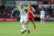 Jonjo Shelvey of Swansea city in action. Barclays Premier league match, Swansea city v Southampton at the Liberty stadium in Swansea, South Wales on Saturday 3rd May 2014.<br /> pic by Andrew Orchard, Andrew Orchard sports photography.