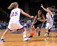 Missouri guard Tiffany Brooks (34) drives between pressure from Kansas State's Shalee Lehning (5) and Danielle Zanotti (25), during the second half at Bramlage Coliseum in Manhattan, Kansas, January 13, 2007.  K-State beat the Tigers 81-66.