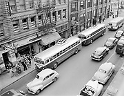 Y-480818A-01. Trolley busses on SW Stark, Portland, between 4th and 5th. August 18, 1948