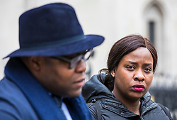 © Licensed to London News Pictures. 23/02/2018. London, UK. Takesha Thomas (R), alongside her husband Lanre Haastrup (L), outside the High Court after judges ruled that doctors at King's College Hospital can withdraw life support for their 11-month-old son Isaiah Haastrup who has suffered severe brain damage. Photo credit: Rob Pinney/LNP