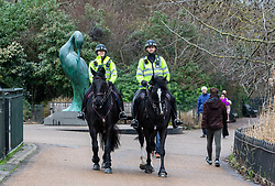 © Licensed to London News Pictures. 19/01/2021. London, UK. Police keep up patrols in Hyde Park in London as Home Secretary Priti Patel warned that there will be tougher enforcement of Covid-19 rules. Today Health Secretary Matt Hancock announced that he will self-isolates after an alert on his Covid-19 app while cases continue to spread through the UK. Last week, Foreign Secretary Dominic Rabb said that lockdown could be lifted in March but with tier systems in place as total Covid-19 deaths reach over 88,000 this weekend. Photo credit: Alex Lentati/LNP
