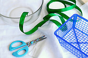 Handcraft concept with scissors basket and ribbon This image has a restriction for licensing in Israel