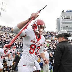 Oct 31, 2009; East Hartford, CT, USA; Rutgers punter Teddy Dellaganna (93) carries on the Scarlet Knight's axe before first half Big East NCAA football action between Rutgers and Connecticut at Rentschler Field