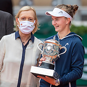 PARIS, FRANCE June 12. Winner Barbora Krejcikova of the Czech Republic with Martina Navratilova who presented the winners trophy after her victory against Anastasia Pavlyuchenkova of Russia on Court Philippe-Chatrier during the final of the singles competition at the 2021 French Open Tennis Tournament at Roland Garros on June 12th 2021 in Paris, France. (Photo by Tim Clayton/Corbis via Getty Images)