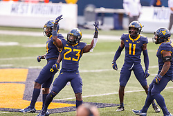 Oct 3, 2020; Morgantown, West Virginia, USA; West Virginia Mountaineers linebacker Tykee Smith (23) celebrates with teammates after intercepting a pass from Baylor Bears quarterback Charlie Brewer (5) during the second overtime at Mountaineer Field at Milan Puskar Stadium. Mandatory Credit: Ben Queen-USA TODAY Sports