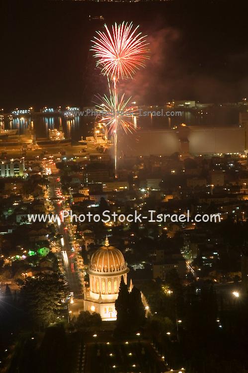 Israel Haifa, fireworks display in the bay, as seen from the Carmel mountain. The bahai shrine can be seen