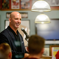 The University of New Mexico men's soccer coach Jeremy Fishbein welcomes guests to a meet and greet at Sammy C's Rock N' Sports Pub & Grille in Gallup Wednesday.