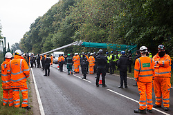 Enforcement agents from the National Eviction Team (NET), working alongside Thames Valley Police officers, commence works to evict environmental activists opposed to the HS2 high-speed rail link from Wendover Active Resistance (WAR) camp on 10th October 2021 in Wendover, United Kingdom. WAR camp, which contains tree houses, tunnels, a cage and a 15-metre tower, is currently the largest of the protest camps set up by Stop HS2 activists along HS2's Phase 1 route between London and Birmingham.