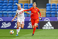 Denmark Ladie's PernilleHarder(captain) (10) battles for possession with Wales Ladie's Sophie Ingle (4) during the Friendly match between Wales Women and Denmark Women at the Cardiff City Stadium, Cardiff, Wales on 13 April 2021.