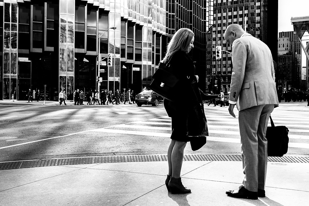 Most mornings I spent a lot of time at the busy intersection of Front and Bay Streets largely because of the huge amount of people traffic that moved from Union Station to the Bay Street office towers. The light is also great in this intersection because of the Royal Bank tower and it's reflective gold nature. These two photographs are connected as a sequence because they tell a story of a couple that both realized the man's shoelace was untied. The woman being concerned jumped down to tie the lace up giving the impression that this was an important day from the man.